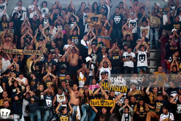 Fans of Pumas cheer for their team during the 13th round match between Necaxa and Pumas UNAM as part of the Torneo Apertura 2017 Liga MX at Victoria...