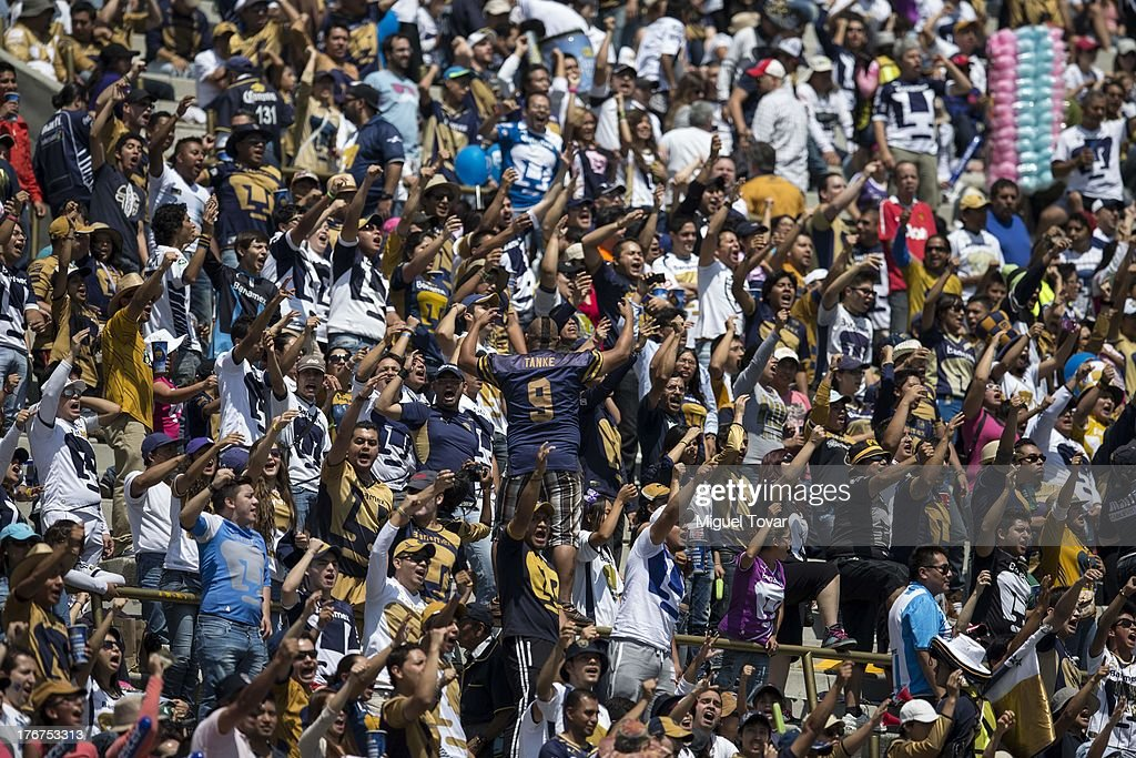 Fans of Pumas sing during a match between Pumas and Leon as part of the Apertura 2013 Liga MX at Olympic stadium, on August 18, 2013 in Mexico City, Mexico.