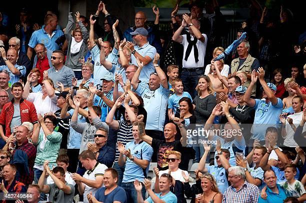 Fans of Randers FC cheer during the Danish Alka Superliga match between AGF Aarhus and Randers FC at Ceres Park on August 2 2015 in Aarhus Denmark
