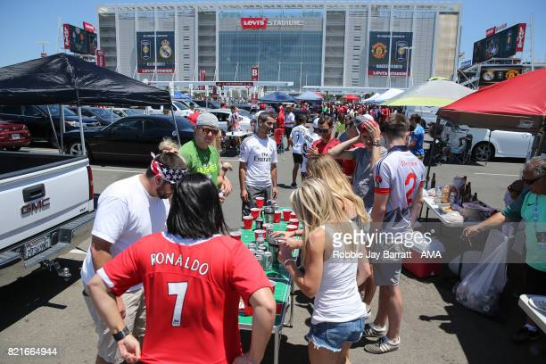 Fans of Real Madrid and Manchester United play beer pong outside the Leiva Stadium prior to the International Champions Cup 2017 match between Real...