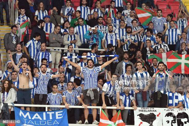 Fans of Real Sociedad cheer for their team during the UEFA Europa League Group L football match between FK Vardar and Real Sociedad at the Filip II...