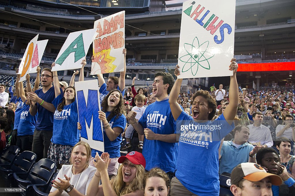 Fans of Rep. Adam Smith, D-Wash., cheer during the Congressional Baseball game where the Democrats beat the Republicans 22-0 at Nationals Park.
