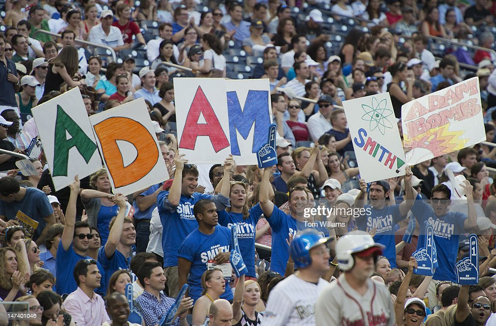 Fans of Rep. Adam Smith, D-Wash., flash their homemade signs during the 51st Annual CQ Roll Call Congressional Baseball Game held at Nationals Park. The Democrats prevailed over the Republicans 18-5.