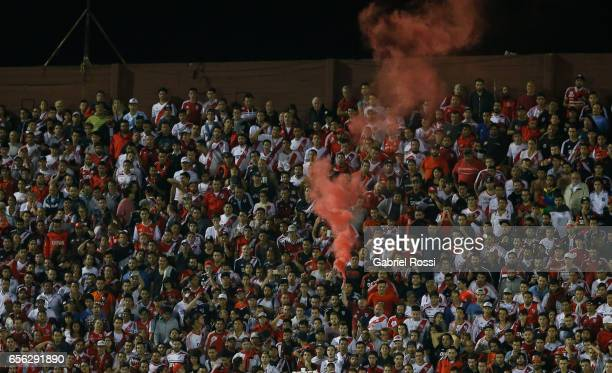 Fans of River cheer for their team during a match between Lanus and River Plate as part of Torneo Primera Division 2016/17 at Ciudad de Lanus Stadium...