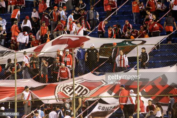Fans of River cheer for their team prior a first leg match between Guarani and River Plate as part of round of 16 of Copa CONMEBOL Libertadores...