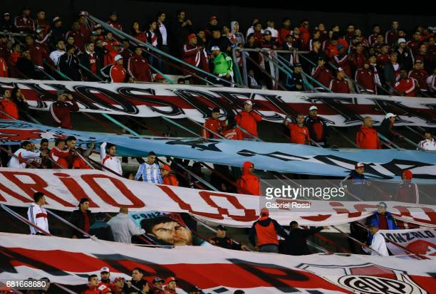 Fans of River Plate cheer for their team during a group stage match between River Plate and Emelec as part of Copa CONMEBOL Libertadores Bridgestone...