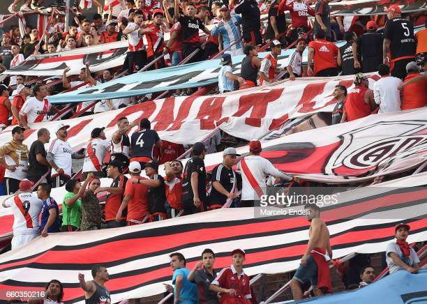 Fans of River Plate cheer for their team during a match between River Plate and Belgrano as part of Torneo Primera Division 2016/17 at Monumental...