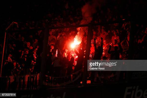 Fans of River Plate cheer for their team during a match between River Plate and Sarmiento as part of Torneo Primera Division 2016/17 at Monumental...