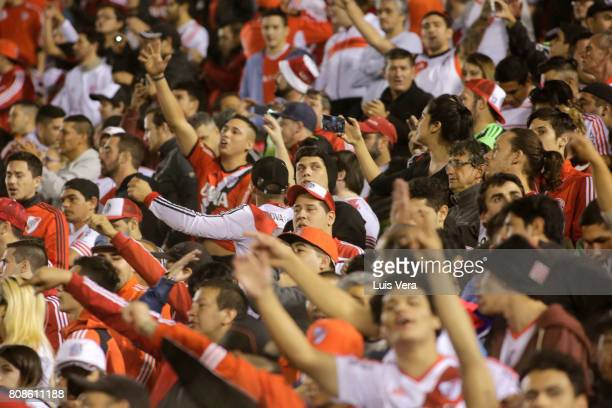 Fans of River Plate cheer for their team prior a first leg match between Guarani and River Plate as part of round of 16 of Copa CONMEBOL Libertadores...
