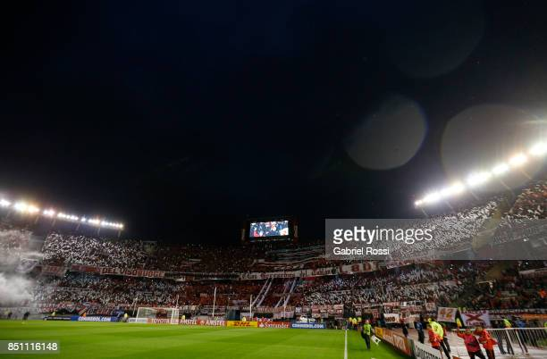 Fans of River Plate cheer their team before a second leg match between River Plate and Wilstermann as part of the quarter finals of Copa CONMEBOL...
