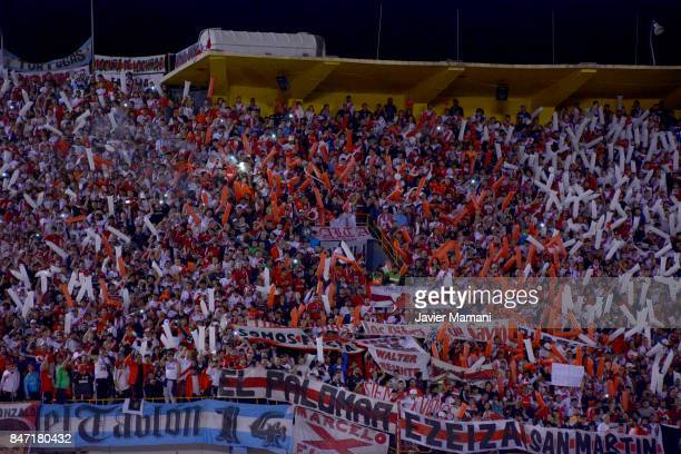 Fans of River Plate cheer their team during a first leg match between Wilstermann and River Plate as part the quarter finals of Copa CONMEBOL...