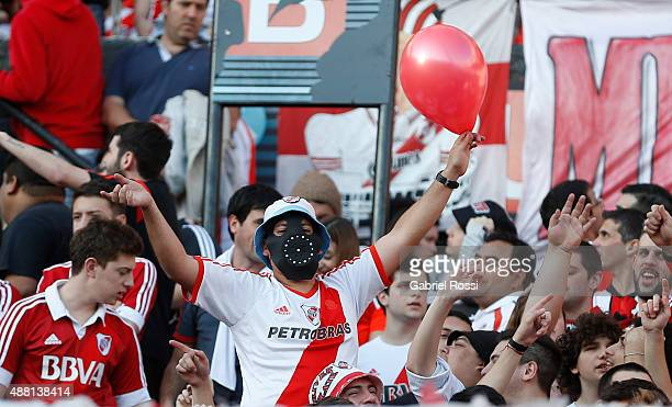 Fans of River Plate cheer their team during a match between River Plate and Boca Juniors as part of 24th round of Torneo Primera Division 2015 at...