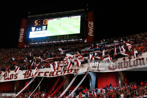 Fans of River Plate cheers for their team during a second leg match between River Plate and Guarani as part of round of 16 of Copa CONMEBOL...