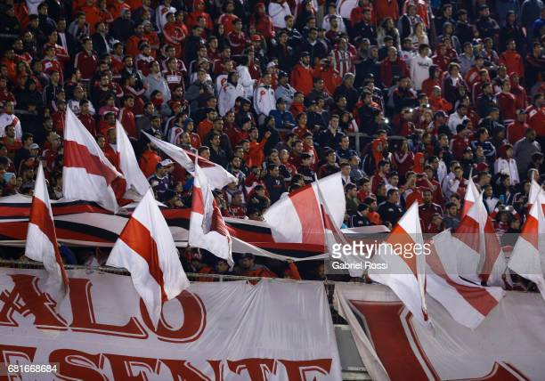 Fans of River Plate hold flags during a group stage match between River Plate and Emelec as part of Copa CONMEBOL Libertadores Bridgestone 2017 at...