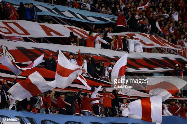 Fans of River Plate wave flags during a group stage match between River Plate and Emelec as part of Copa CONMEBOL Libertadores Bridgestone 2017 at...