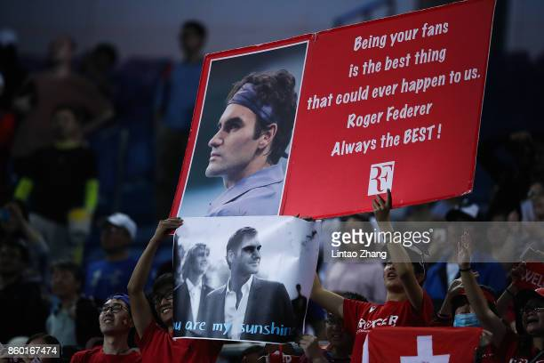 Fans of Roger Federer cheer during the Men's singles match between Roger Federer of Switzerland and Diego Schwartzman of Argentina on day four of...