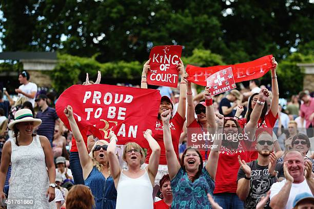 Fans of Roger Federer of Switzerland on Murray mound show their support as they watch his Gentlemen's Singles Final match against Novak Djokovic of...