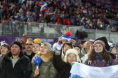 Fans of Russia watch qualifying of the men's moguls at Rosa Khutor Extreme Park during the Winter Olympics in Sochi Russia Monday Feb 10 2014