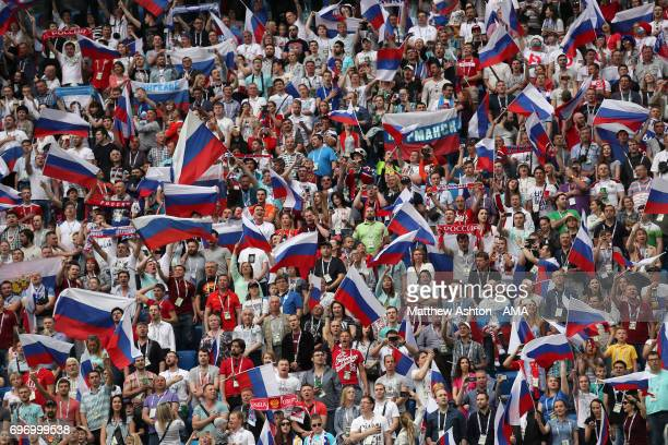 Fans of Russia wave flags during the Group A FIFA Confederations Cup Russia 2017 match between Russia and New Zealand at Saint Petersburg Stadium on...