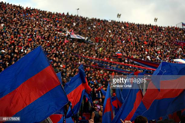 Fans of San Lorenzo cheer for their team prior a match between San Lorenzo and Rosario Central as part of 27th round of Torneo Primera Division 2015...