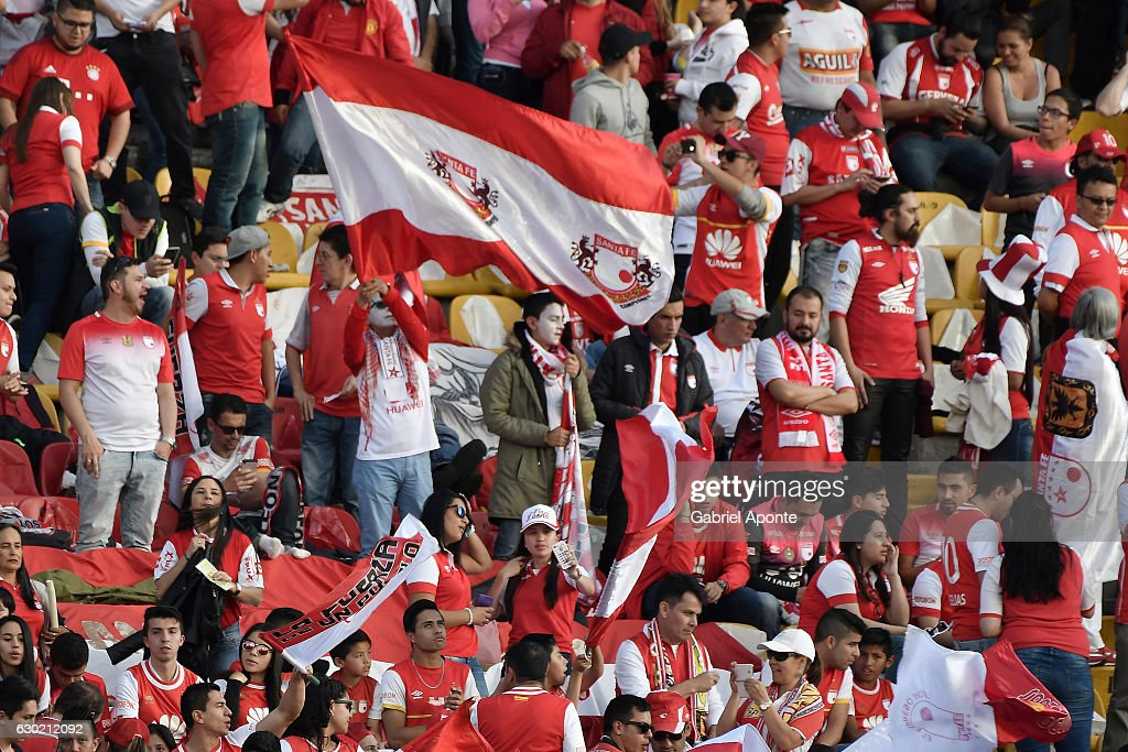 Fans of Santa Fe cheer for their team during a second leg final match between Santa Fe and Deportes Tolima as part of Liga Aguila II 2016 at El Campin Stadium on December 18, 2016 in Bogota, Colombia.