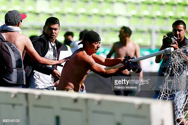 Fans of Santiago Wanderers and Colo Colo scuffle prior to the 15th round match between Santiago Wanderers and Colo Colo as part of the Campeonato...