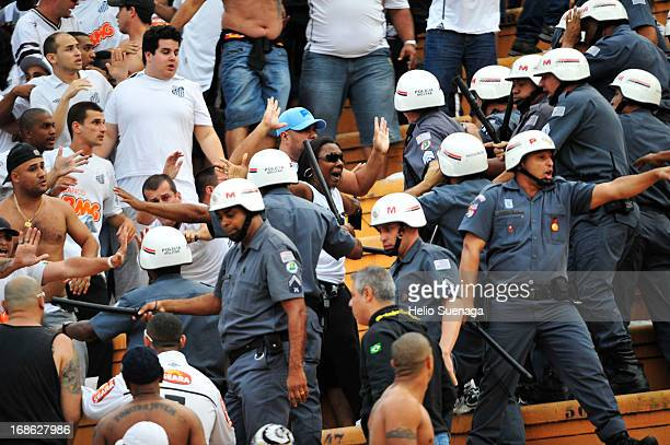 Fans of Santos fight amongst themselves and military police come to contain turmoil during the match between Corinthians and Santos as part of...