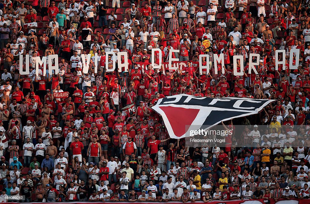 Fans of Sao Paulo celebrates during the match between Sao Paulo and Santos for the Brazilian Series A 2014 at Estadio do Morumbi on August 24 2014 in...