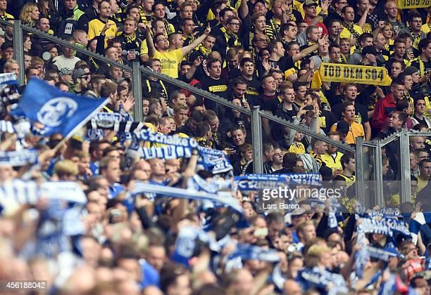 Fans of Schalke and Dortmund are seen during the Bundesliga match between FC Schalke 04 and Borussia Dortmund at Veltins Arena on September 27 2014...