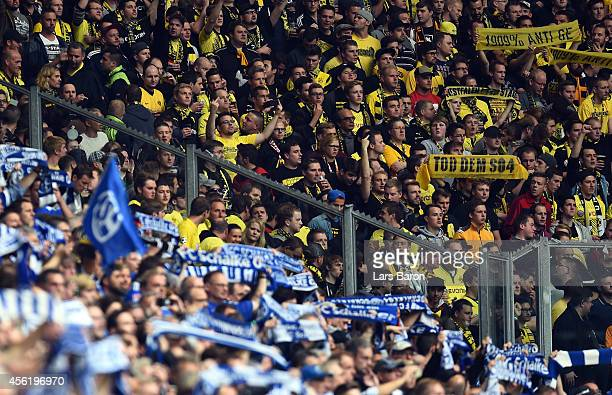 Fans of Schalke and Dortmund are seen during the Bundesliga match between FC Schalke 04 and Borussia Dortmund at Veltins Arena on September 27 2014...