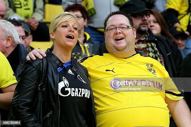 Fans of Schalke and of Dortmund sing prior to the Bundesliga match between Borussia Dortmund and FC Schalke 04 at Signal Iduna Park on November 8...
