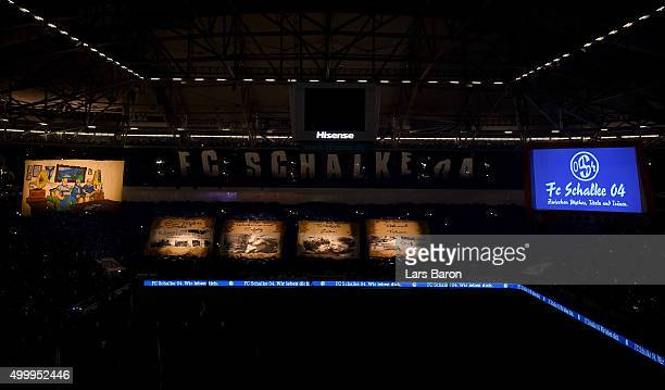 Fans of Schalke are doing a choreography prior to the Bundesliga match between FC Schalke 04 and Hannover 96 at VeltinsArena on December 4 2015 in...