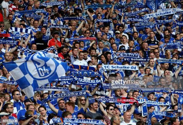 Fans of Schalke are seen during the Bundesliga match between FC Schalke 04 and Karlsruher SC at the VeltinsArena on April 11 2009 in Gelsenkirchen...