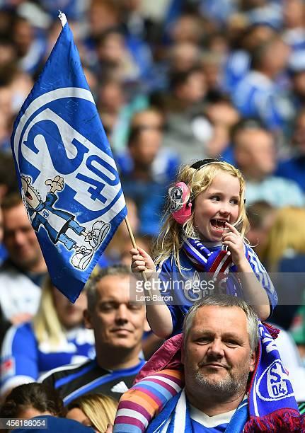 Fans of Schalke are seen prior to the Bundesliga match between FC Schalke 04 and Borussia Dortmund at Veltins Arena on September 27 2014 in...