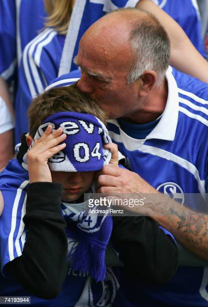 Fans of Schalke cry during the Bundesliga match between Schalke 04 and Arminia Bielefeld at the Veltins Arena on May 19 2007 in Gelsenkirchen Germany