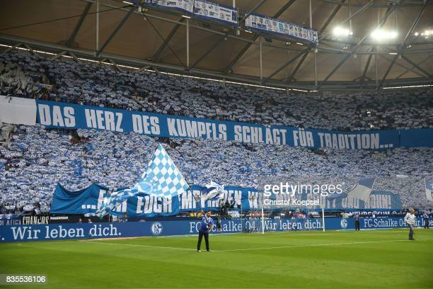 Fans of Schalke prior to the Bundesliga match between FC Schalke 04 and RB Leipzig at VeltinsArena on August 19 2017 in Gelsenkirchen Germany