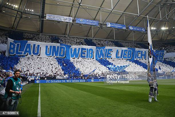 Fans of Schalke show a banner during the Bundesliga match between FC Schalke 04 and VfB Stuttgart at Veltins Arena on May 2 2015 in Gelsenkirchen...
