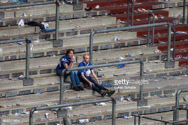 Fans of Schalke sit on the tribune after the Bundesliga match between FC Schalke 04 and Borussia Dortmund at VeltinsArena on April 1 2017 in...