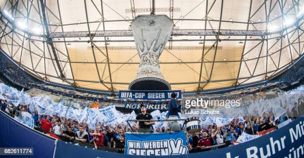 Fans of Schalke support their team with a choreography prior to the Bundesliga match between FC Schalke 04 and Hamburger SV at VeltinsArena on May 13...