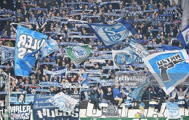 Fans of Schalke watch during the Bundesliga match between Hannover 96 and FC Schalke 04 at the HDI Arena on April 30 2016 in Hanover Lower Saxony