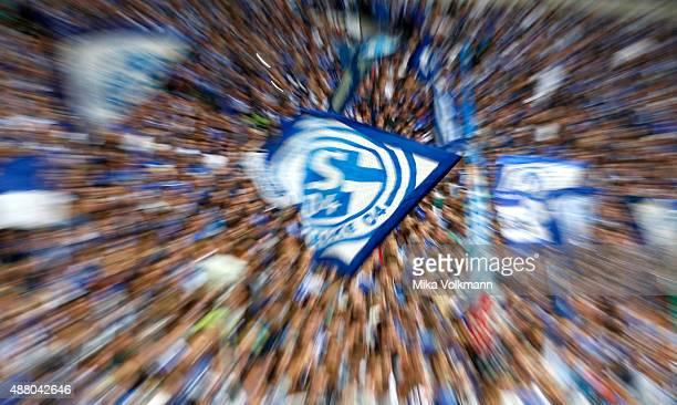 Fans of Schalke wave a flag during the Bundesliga match between FC Schalke 04 and 1 FSV Mainz 05 at VeltinsArena on September 13 2015 in...