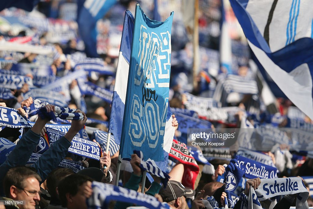 Fans of Schalke wave flags during the Bundesliga match between FC Schalke 04 and TSG 1899 Hoffenheim at Veltins-Arena on March 30, 2013 in Gelsenkirchen, Germany.