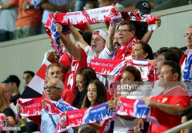 Fans of Sevilla FC cheer for their team during of the UEFA Champions League playoff match between Medipol Basaksehir and Sevilla FC at Basaksehir...