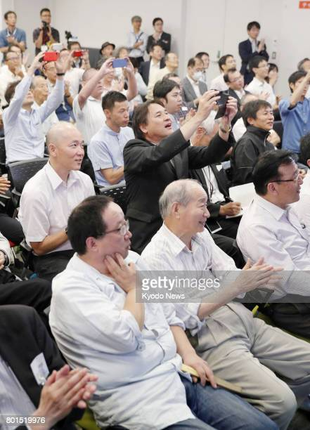 Fans of shogi or Japanese chess celebrate a record 29th consecutive victory by Sota Fujii at 14 the youngest professional player of the game in Tokyo...