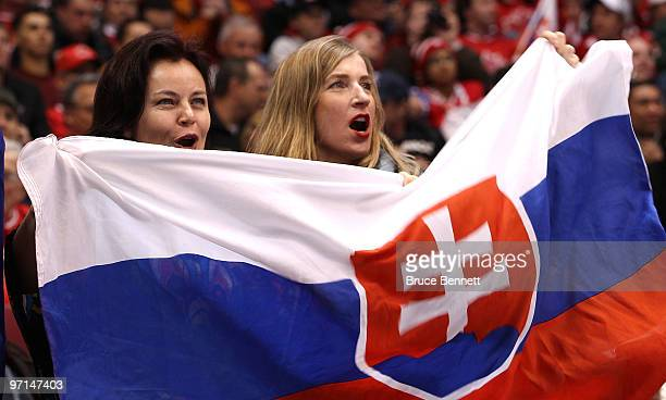 Fans of Slovakia hold up the countries flag during the ice hockey men's bronze medal game between Finland and Slovakia on day 16 of the Vancouver...