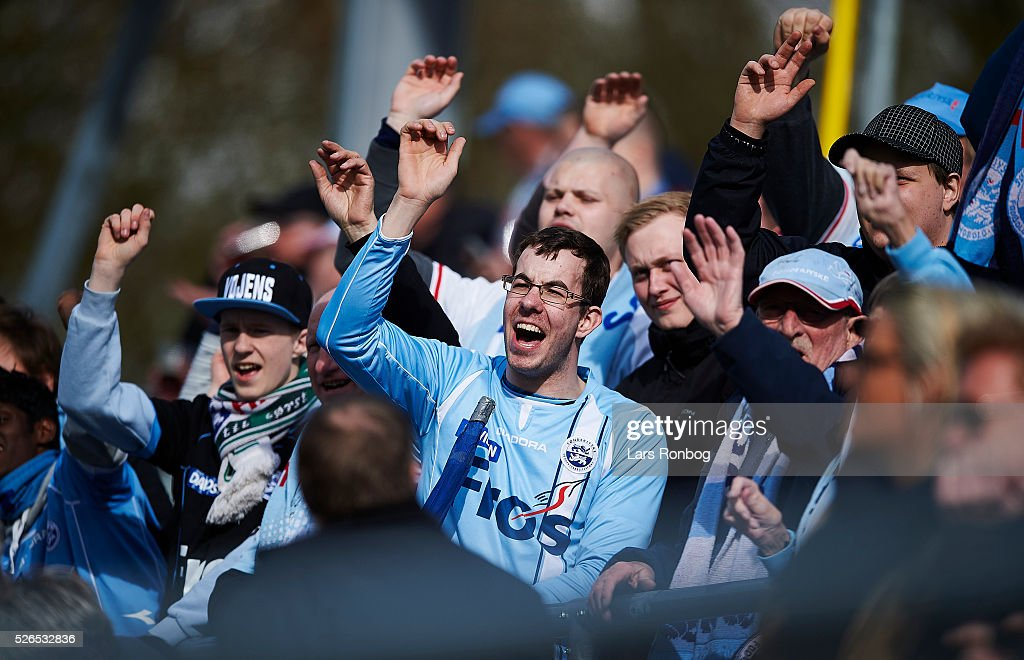 Fans of Sonderjyske cheer during the Danish Alka Superliga match between Hobro IK and Sonderjyske at DS Arena on April 30, 2016 in Hobro, Denmark.