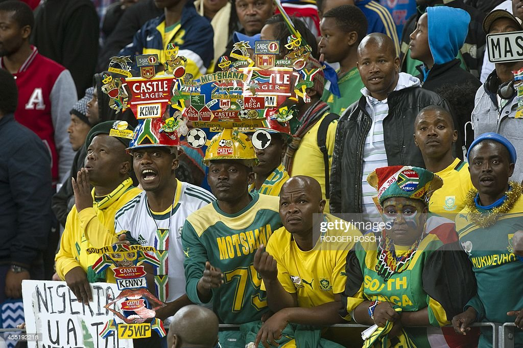 Fans of South Africa's football team some of them wearing Makarapa hats cheer during the 2015 African Cup of Nations qualifying football match...