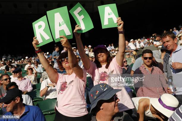 Fans of Spain's Rafael Nadal wait for him to play against US player Donald Young during their men's singles second round match on the third day of...