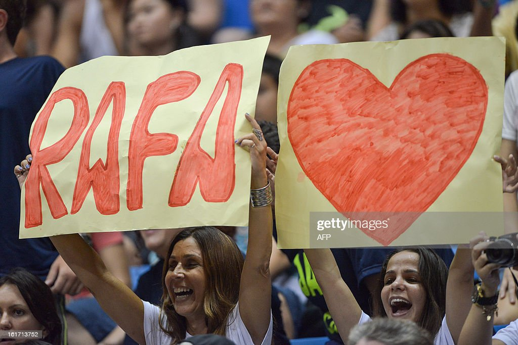 Fans of Spanish tennis player Rafael Nadal cheer during his Brazil Open single match against Brazilian Joao Souza, at Ibirapuera gymnasium in Sao Paulo, Brazil, on February 14, 2013. Nadal withdrew his doubles match yesterday because of his left knee concern. AFP PHOTO/Yasuyoshi CHIBA