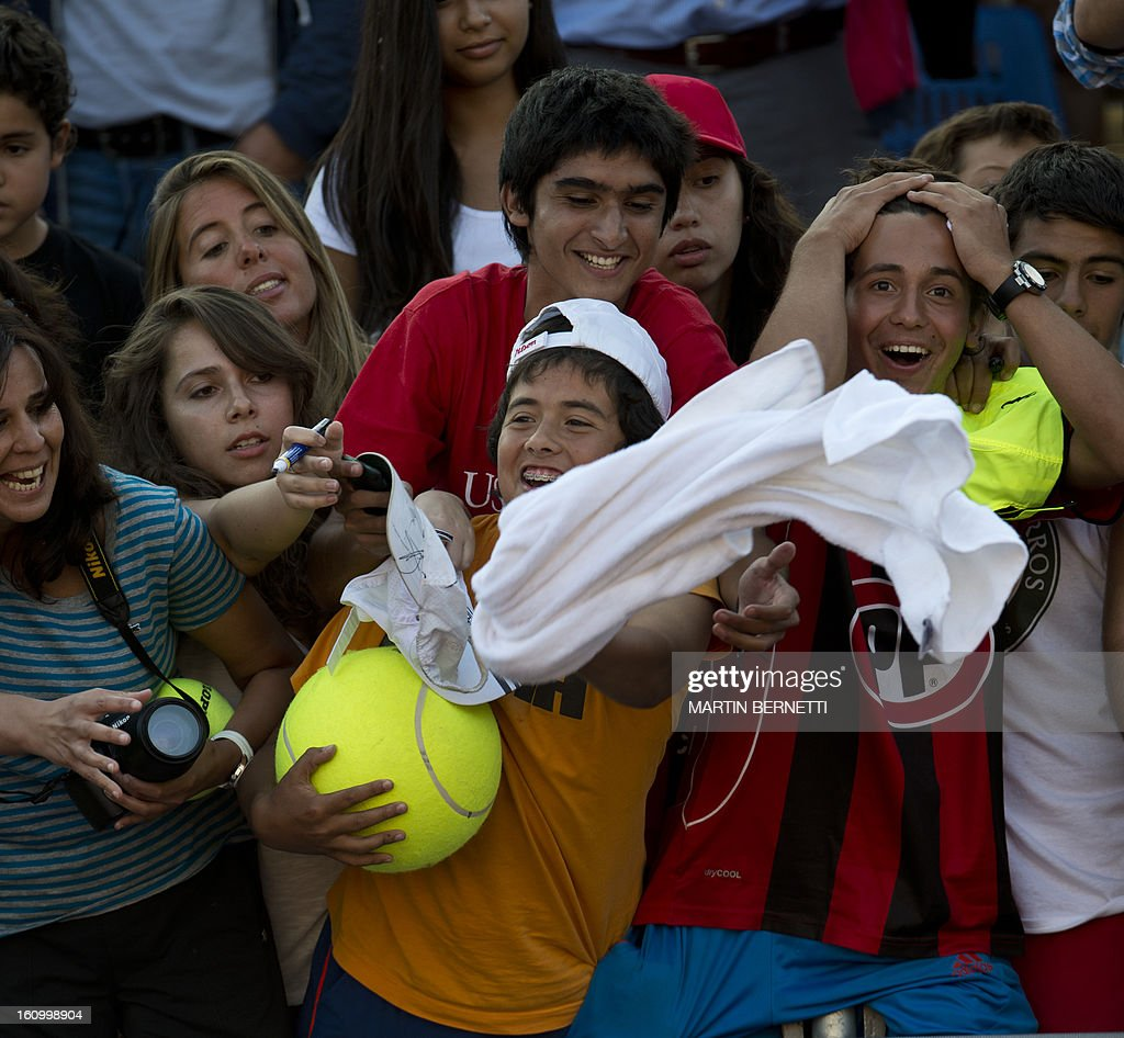 Fans of Spanish tennis player Rafael Nadal rejoice after he throwed them one of his towels at the end of his ATP Vina del Mar tournament quarterfinal singles match against also Spanish Daniel Gimeno-Traver (not in frame), in Vina del Mar, about 120 km northwest of Santiago, on February 8 , 2013.